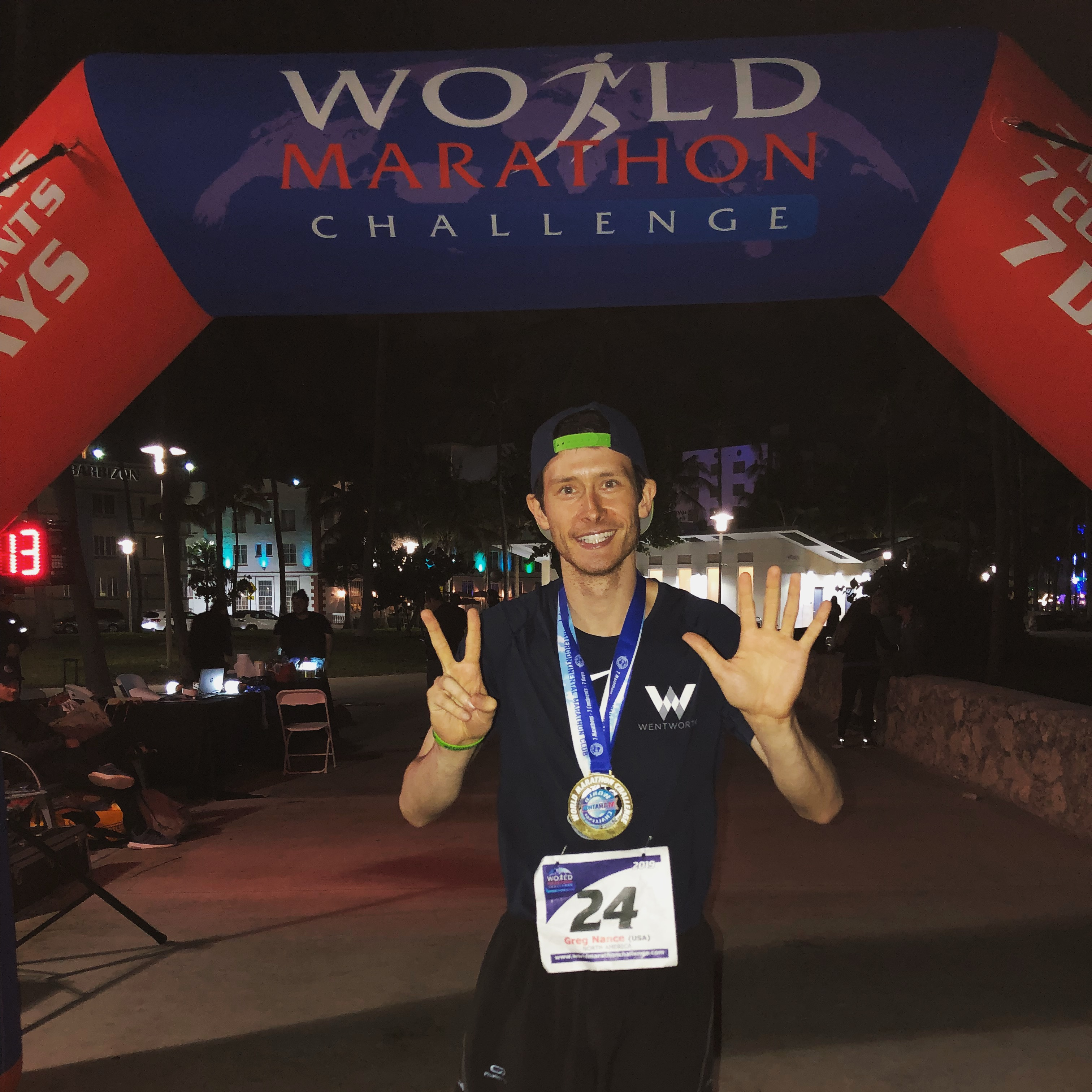 Greg Nance crosses the finish line of the World Marathon Challenge in Miami