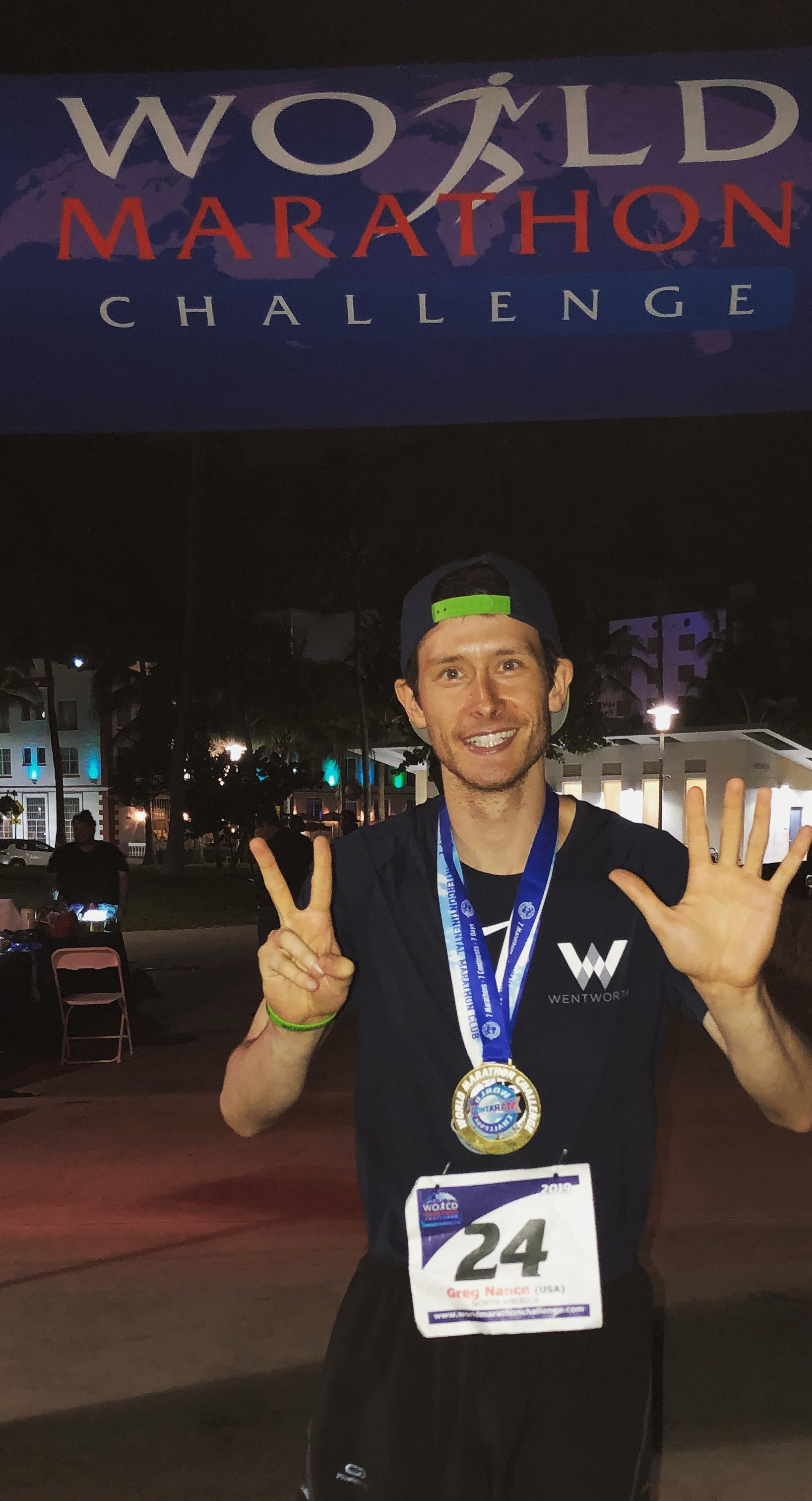 Greg Nance crossing the World Marathon Challenge finish line in Miami