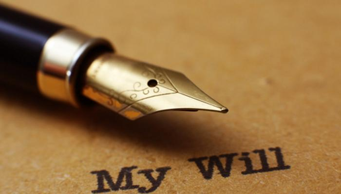 A pen tip and a cover page of a will