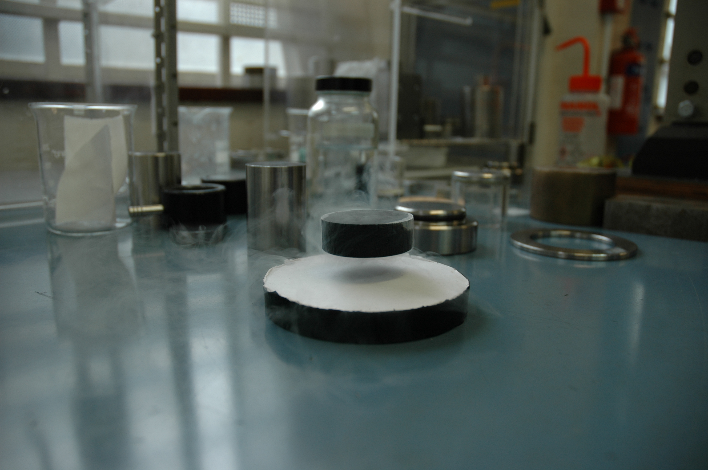 Bulk superconductor levitated by a permanent magnet