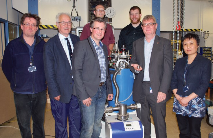 David Cardwell (holding superconductor) and the team.
