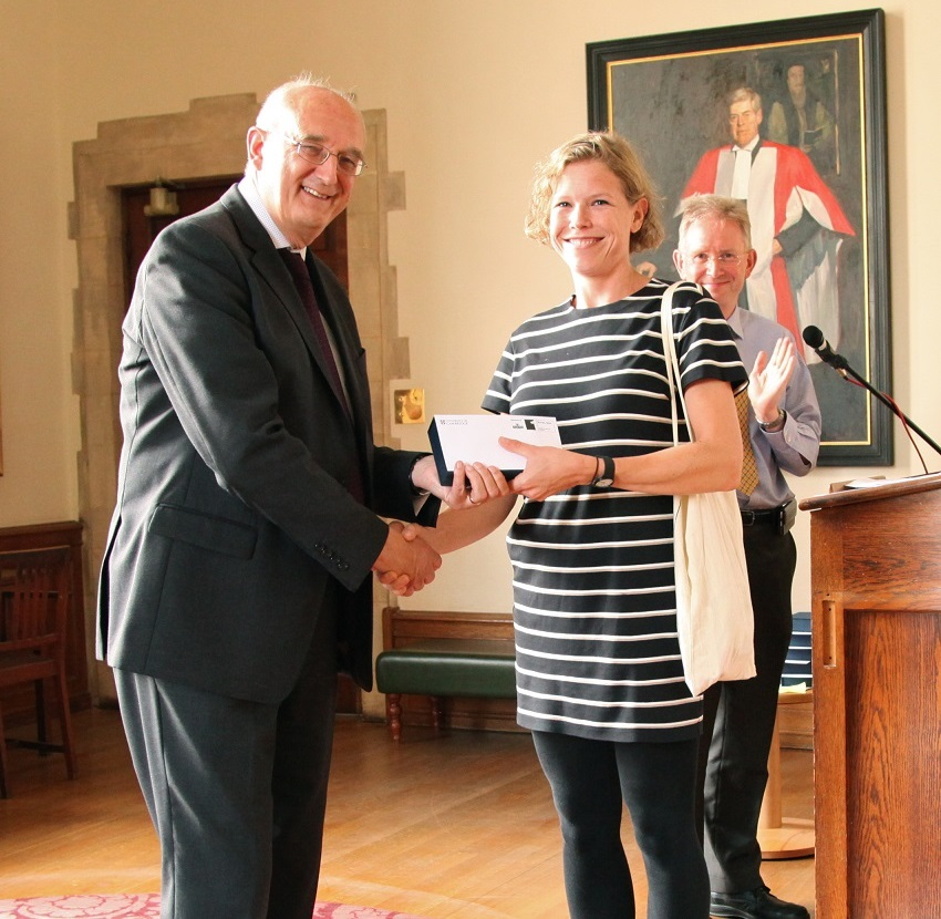 Dr Hazel Wilkinson receiving her award from the University of Cambridge's Vice-Chancellor
