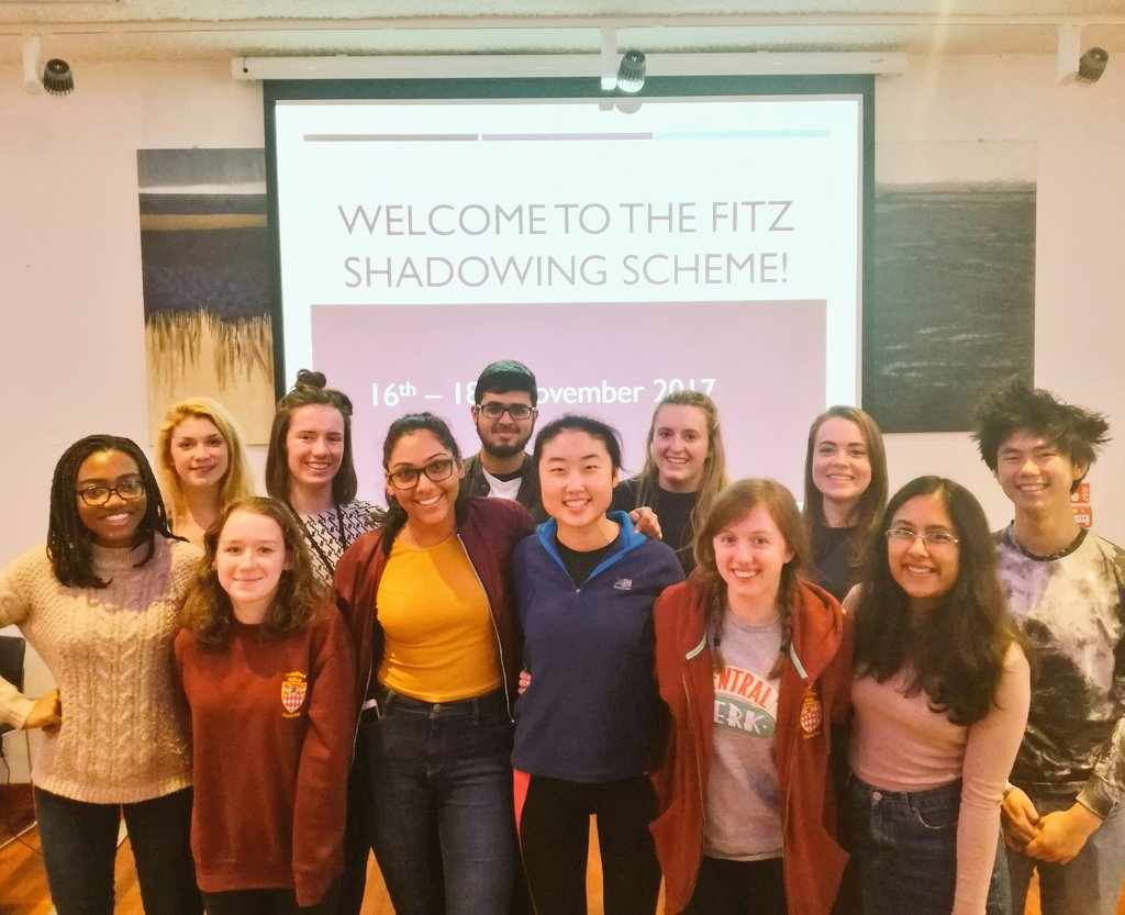 "Twelve student mentors from the 2017 Fitzwilliam College Shadowing Scheme, backdrop text reads ""Welcome to the Fitz Shadowing Scheme!"""