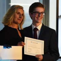 Conor Monighan receives first prize from The Right Honourable Lady Justice Rafferty